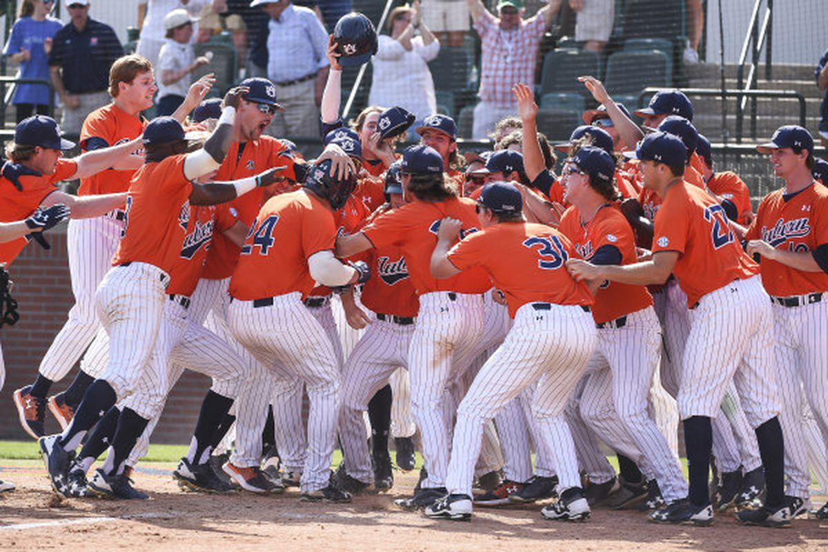 Teammates celebrate with Conor Davis after his walk-off home run against South Carolina.