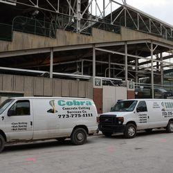 5:31 p.m. Concrete cutting service trucks, parked on Waveland -