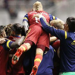 """RSL players celebrate with Ned Grabavoy following his goal as Real Salt Lake and the San Jose Earthquakes play Saturday, Oct. 11, 2014, at Rio Tinto Stadium in Sandy.  <img src=""""http://beacon.deseretconnect.com/beacon.gif?cid=234840&pid=83"""" />"""