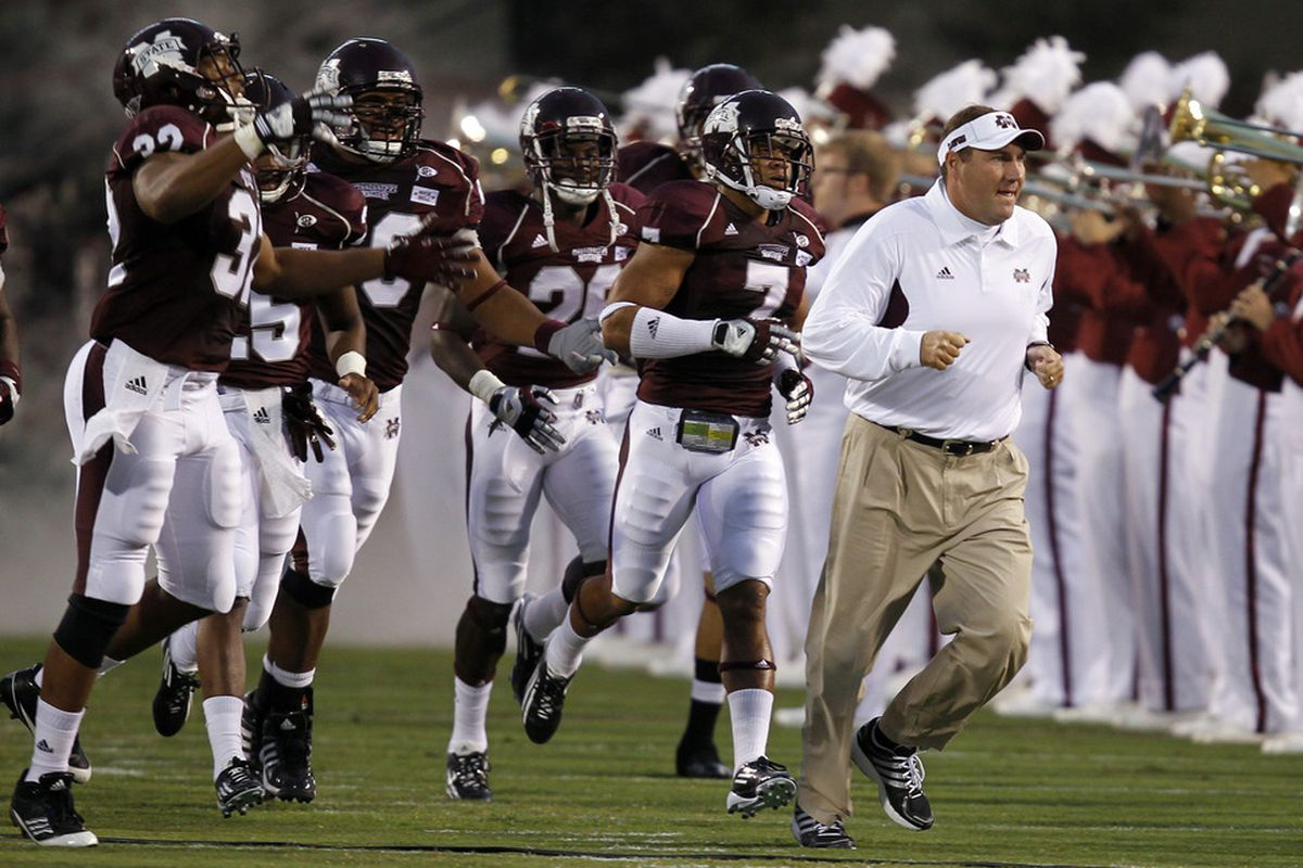 STARKVILLE, MS - SEPTEMBER 15:  Coach Dan Mullens of the Mississippi State Bulldogs leads the team onto the field to start the game against LSU on September 15, 2011 at Davis Wade stadium in Starkville, Mississippi. (Photo by Butch Dill/Getty Images)