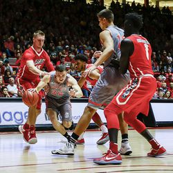 Idaho's Balint Mocsan (32) splits New Mexico's defense during the first half of an NCAA college basketball game in Albuquerque, N.M., Friday, Nov. 11, 2016.