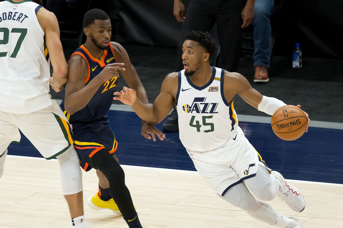 Utah Jazz guard Donovan Mitchell (45) dribbles the ball around a screen by center Rudy Gobert (27) against Golden State Warriors forward Andrew Wiggins (22) during the second half at Vivint Smart Home Arena.