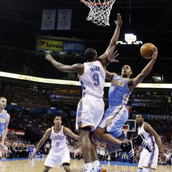 Denver Nuggets guard Arron Afflalo (6) shoots as Oklahoma City Thunder forward Serge Ibaka (9) defends during the first quarter of an NBA basketball game in Oklahoma City, Wednesday, April 25, 2012.