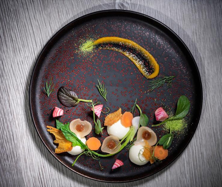 Smoked eel, chicken skin, pickled onions, and brown sauce at Verveine in the New Forest