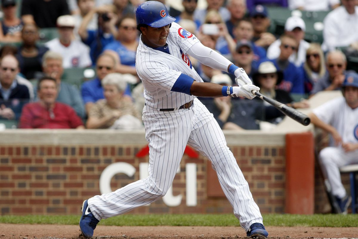 Chicago, IL, USA; Chicago Cubs shortstop Starlin Castro hits a single against the Cincinnati Reds at Wrigley Field. Credit: Jerry Lai-US PRESSWIRE