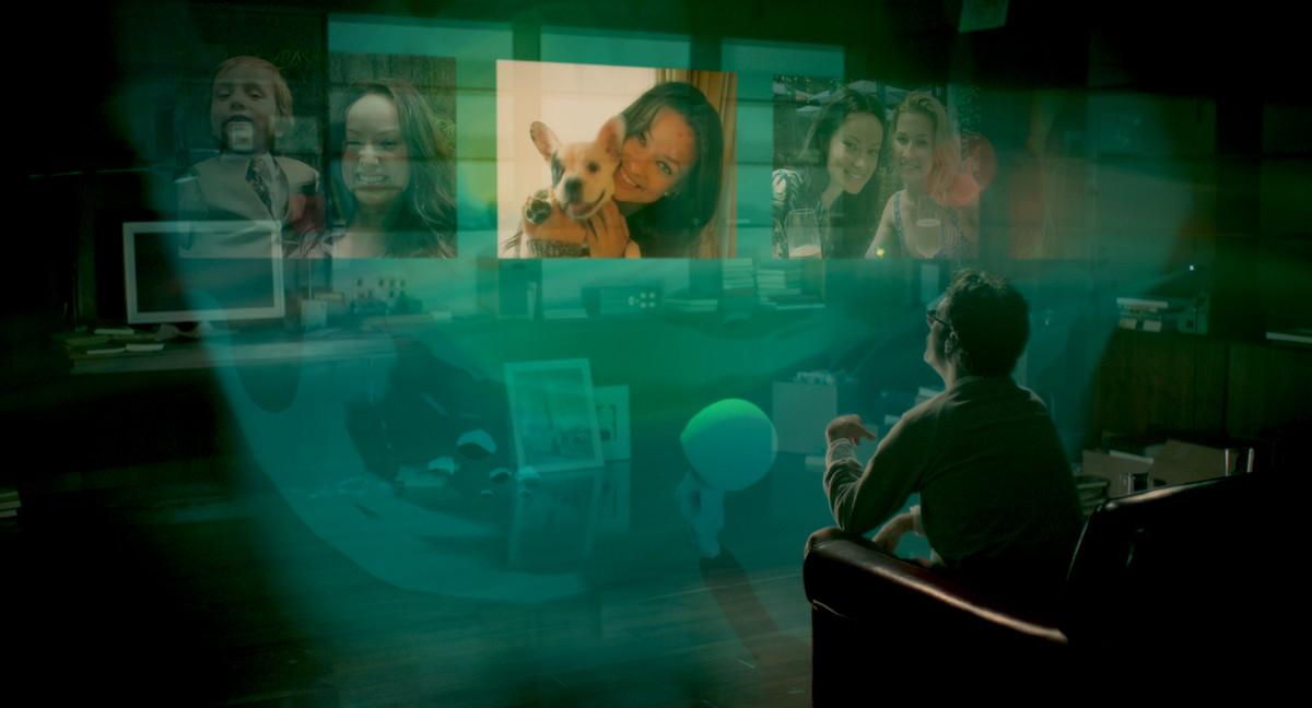 Her: Joaquin Phoenix watches his hologram tv