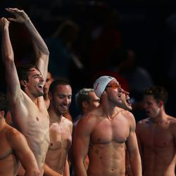 Camille Lacourt, Fabien Gilot and Jeremy Stravius of France celebrate after the USA are disqualified and they are instated as winners of the Swimming Men's   Medley 4x100m Relay Final.