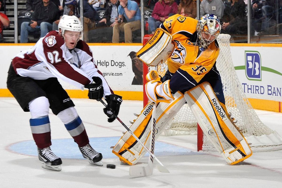 NASHVILLE, TN - MARCH 08: Pekka Rinne #35 of the Nashville Predators dumps the puck away from Gabriel Landeskog #92 of the Colorado Avalanche at Bridgestone Arena on March 8, 2012 in Nashville, Tennessee.  (Photo by Frederick Breedon/Getty Images)