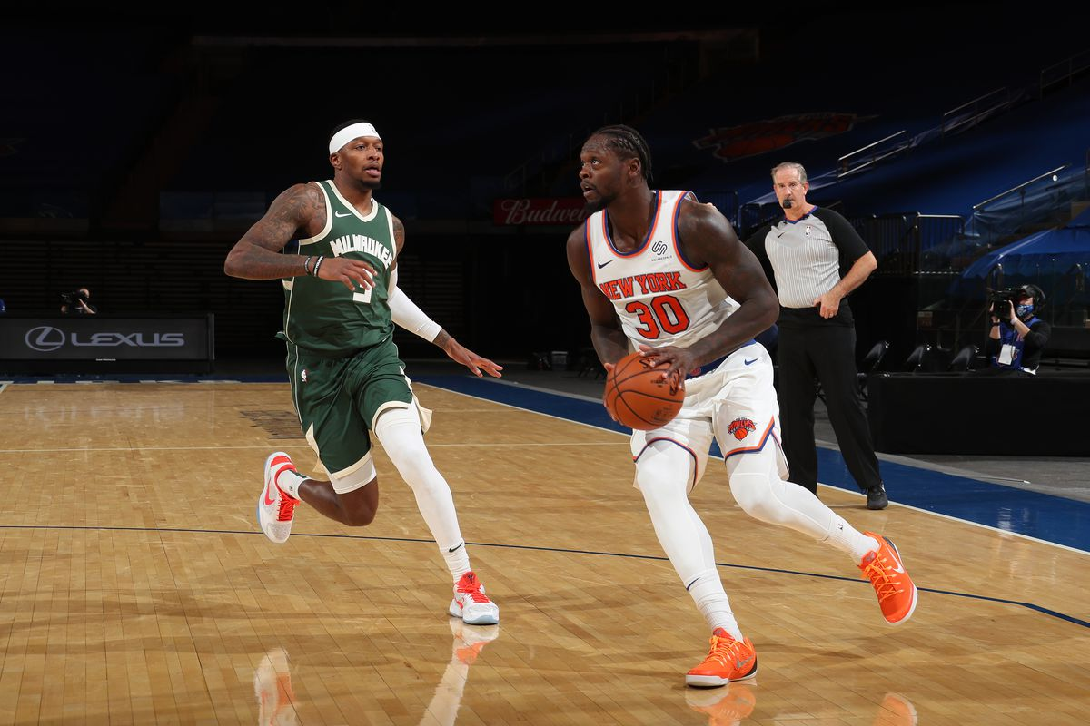 Julius Randle of the New York Knicks handles the ball during the game against the Milwaukee Bucks on December 27, 2020 at Madison Square Garden in New York City, New York.