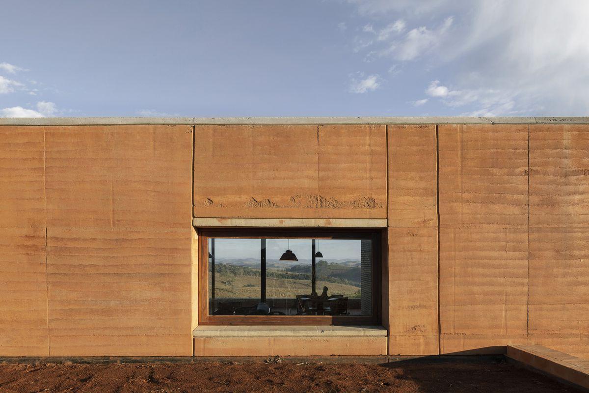 Rectangular window in a rammed earth house.