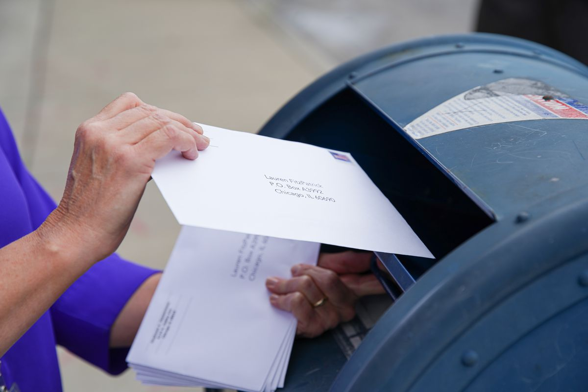 A Sun-Times reporter mails an envelope in September as part of a test of the mail-in ballot process.