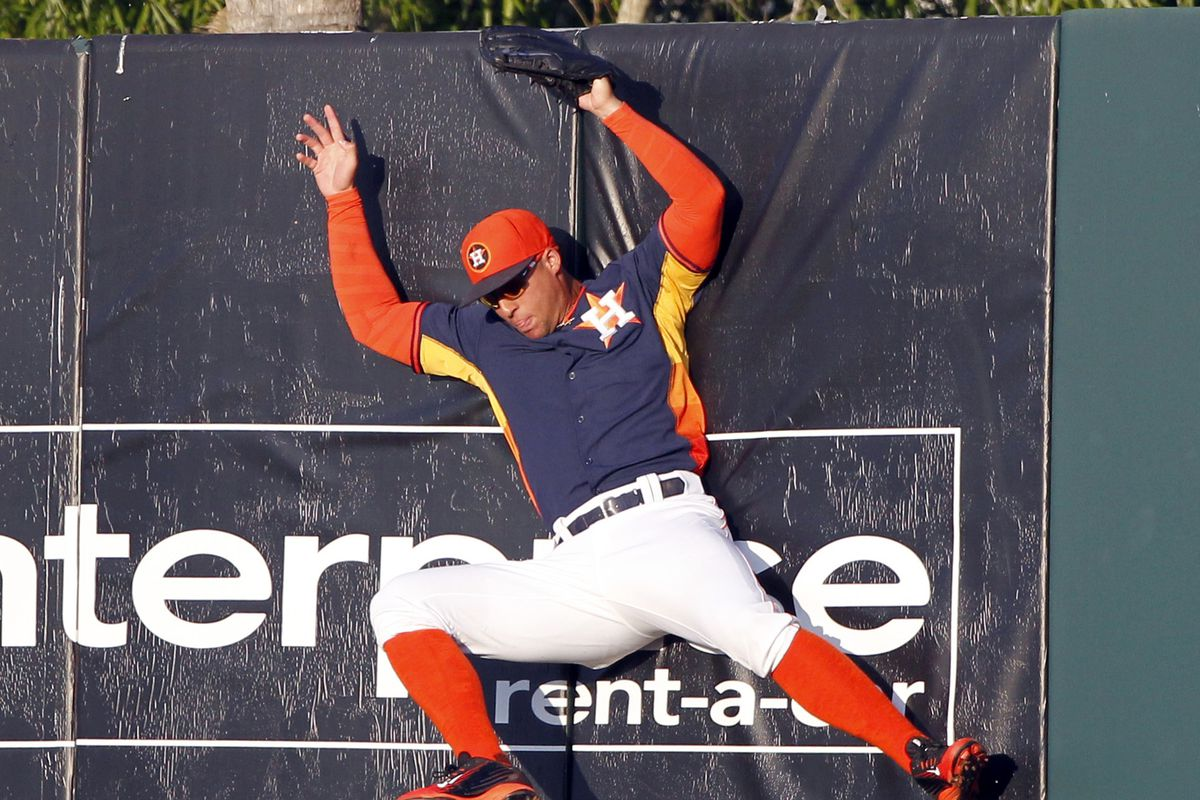 I normally don't use pictures of the other team, but this one of George Springer making a catch at the wall is too good not to use.