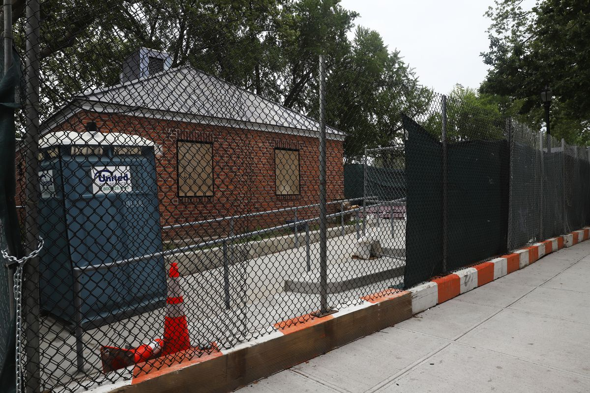 An inaccessible portable toilet can be seen through fencing surrounding the non-functioning bathrooms at Brownsville's Betsy Head Park. June 19, 2021,