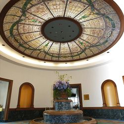 A fountain and a stained-glass dome welcome visitors to the JSMB's 10th floor.