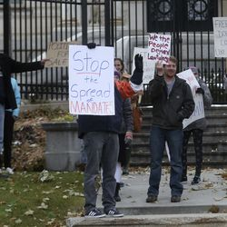 Protesters gather outside of the Governor's Mansion Governor's Mansion in Salt Lake City on Monday, Nov. 9, 2020, to protest Gov. Gary Herbert's mask mandate and new COVID-19 restrictions.