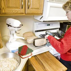 To help save money, Florence Sadler bakes bread at her home in Fruit Heights Monday.