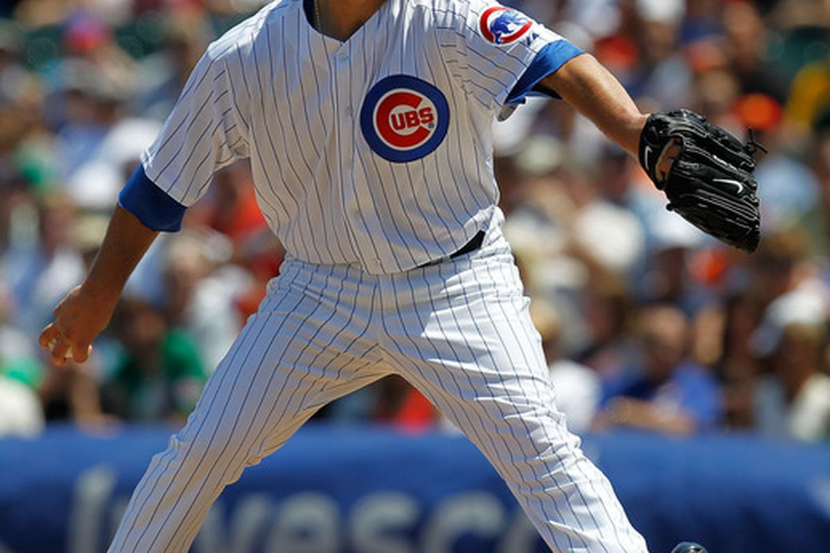 CHICAGO - JUNE 17: Starting pitcher Randy Wells #36 of the Chicago Cubs delivers the ball against the Oakland Athletics at Wrigley Field on June 17, 2010 in Chicago, Illinois. (Photo by Jonathan Daniel/Getty Images)