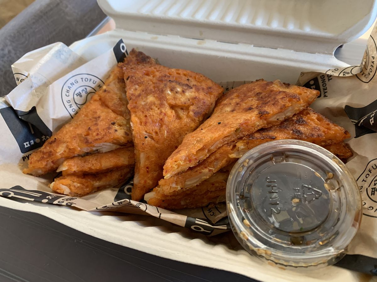 Kimchi pancakes packed for takeout