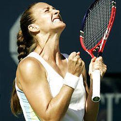 Mary Pierce celebrates after winning her match vs. Elena Dementieva during semifinal play Friday.