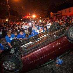 Kentucky fans flip a car on State Street as they celebrate Kentucky's 69-61 win over Louisville in an NCAA Final Four semifinal college basketball tournament game, Saturday, March 31, 2012, in Lexington, Ky.