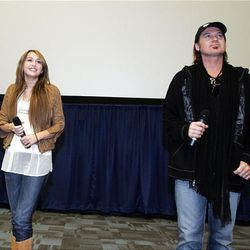 """Miley Cyrus and her father Billy Ray Cyrus greet fans and media members at a Disney Pictures opening weekend surprise at the Megaplex 20 in South Jordan Friday prior to the premier of her movie, """"Hannah Montana."""""""