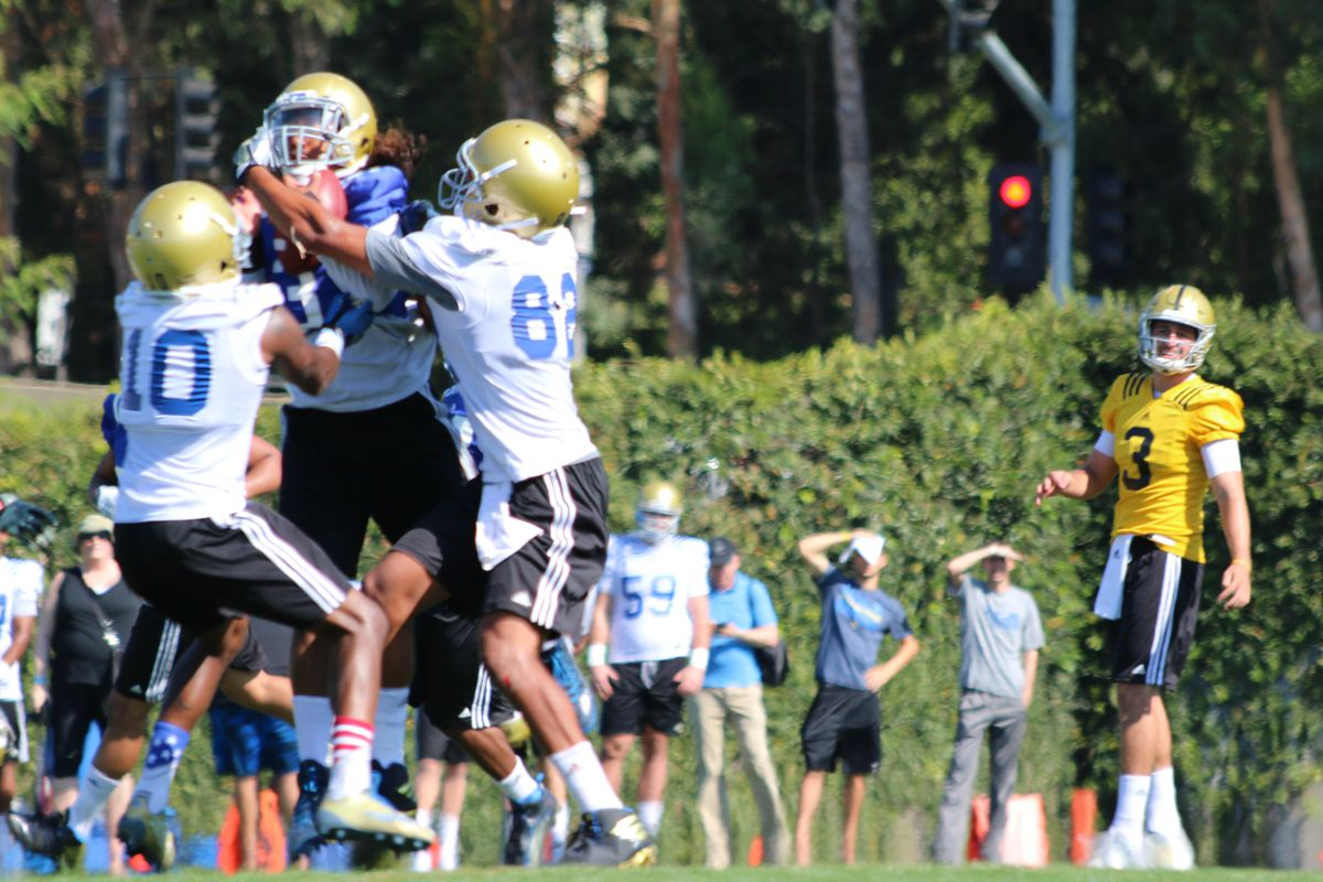 Randall Goforth comes up with the pic as Josh Rosen looks on in disgust.