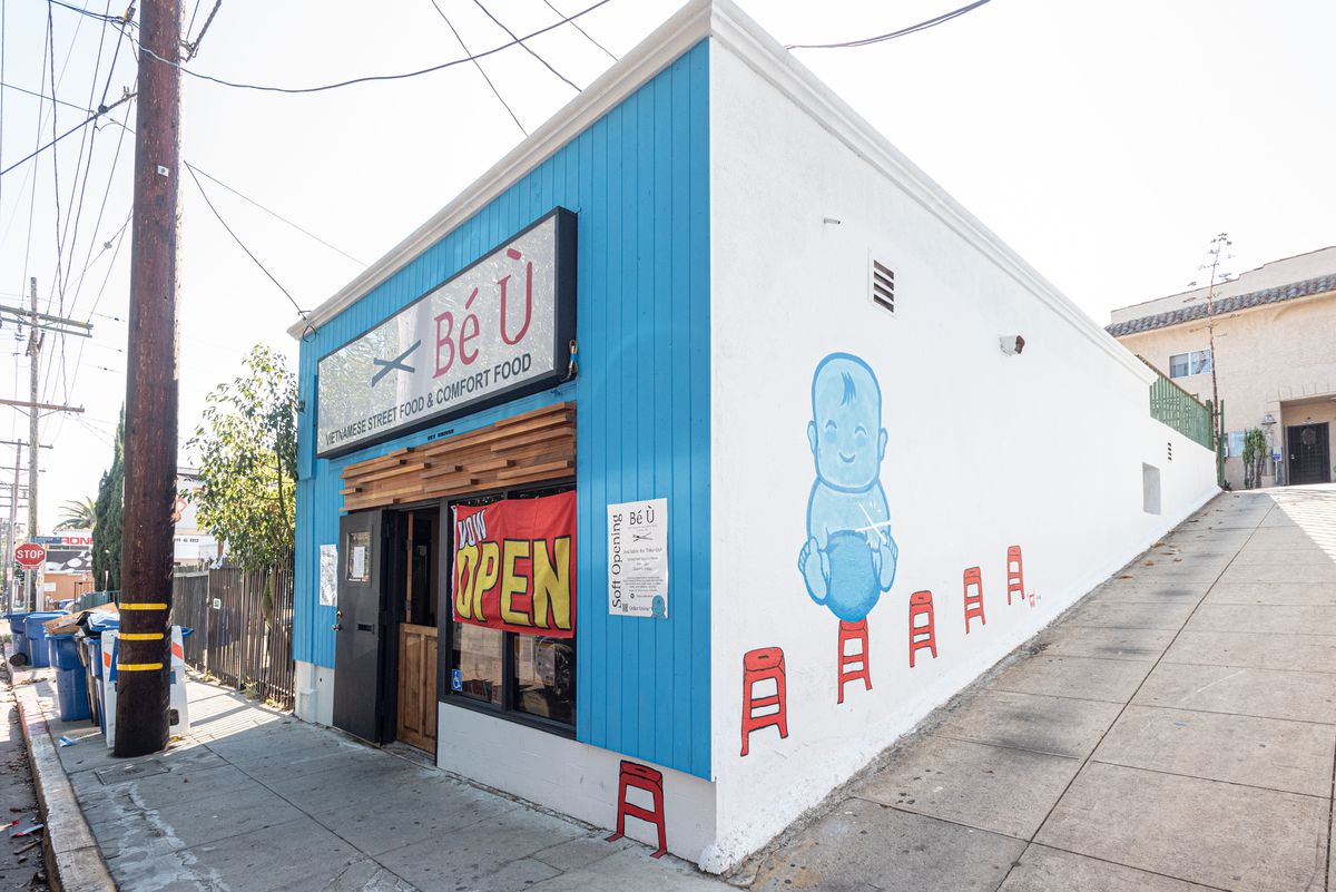 Be U in Silver Lake/East Hollywood painted blue with a mural featuring a chubby baby and red plastic stools.