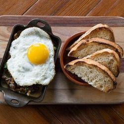"""Start your day off at The Winchester (1001 North Winchester Avenue). The <a href=""""http://chicago.eater.com/archives/2014/02/18/post-44.php"""">brand-new neighborhood spot</a> has a weekend brunch that serves up avocado toast, mixed-grain porridge, and a brea"""