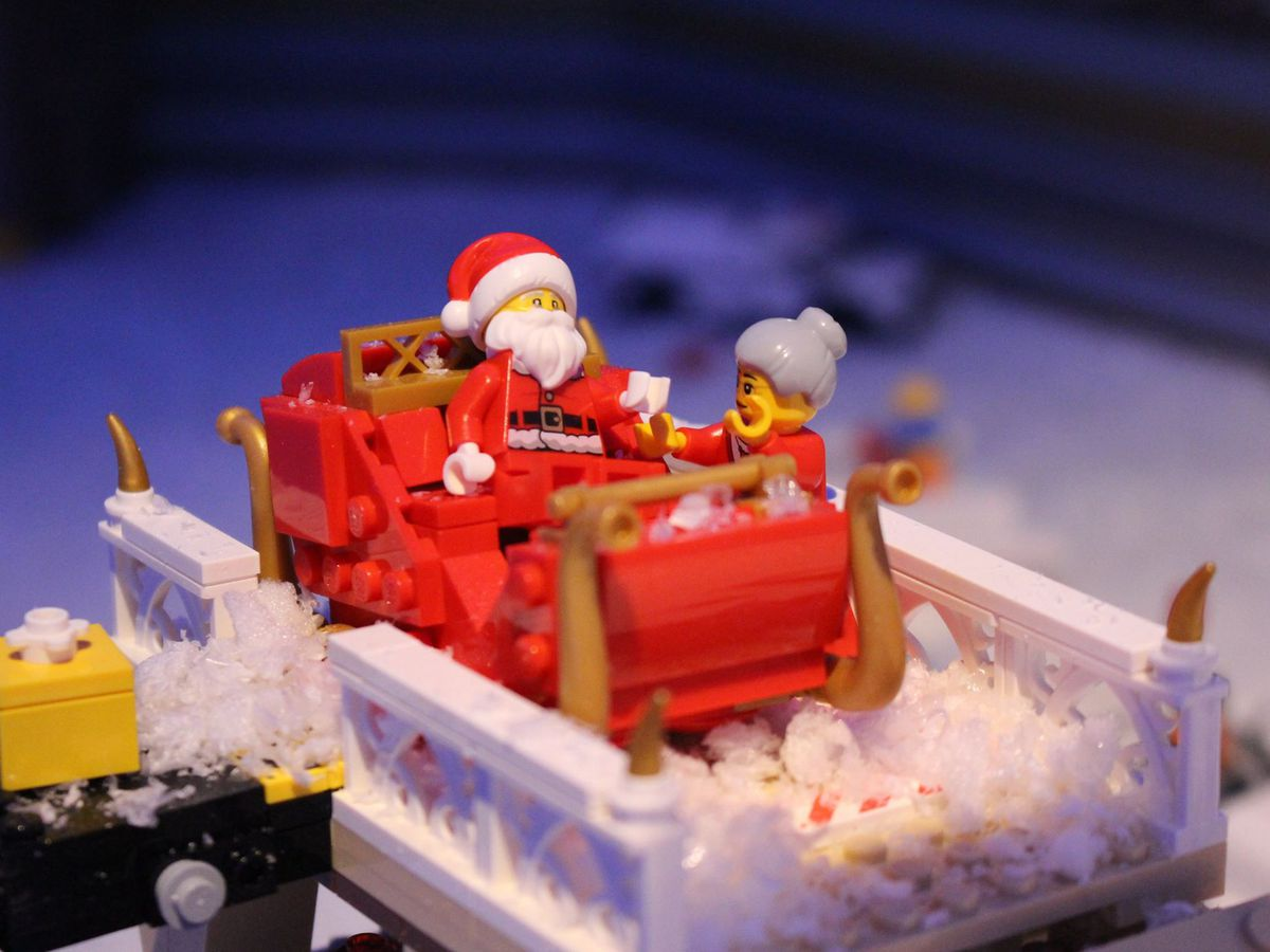 Santa in a sleigh with Mrs. Claus, all made of LEGOs.