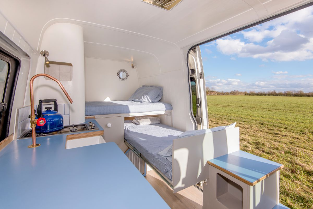 Converted Camper Van Boasts A Hidden Pull Out Guest Bed