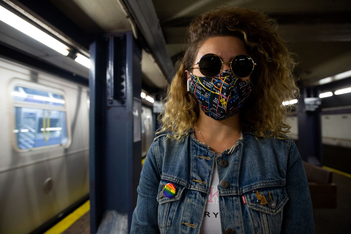 Teona Nesta in front of an A train in Brooklyn, June 8, 2020.