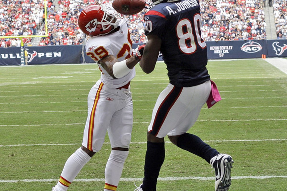 HOUSTON - OCTOBER 17:  Andre Johnson #80 of the Houston Texans has a pass broken up by cornerback Eric Berry #39 of the Kansas City Chiefs at Reliant Stadium on October 17 2010 in Houston Texas.  (Photo by Bob Levey/Getty Images)