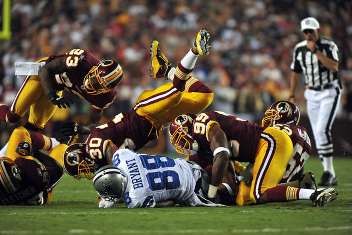 LANDOVER - SEPTEMBER 12:  LaRon Landry #30 of the Washington Redskins tackles Dez Bryant #88 of the Dallas Cowboys during the NFL season opener at FedExField on September 12 2010 in Landover Maryland. (Photo by Larry French/Getty Images)