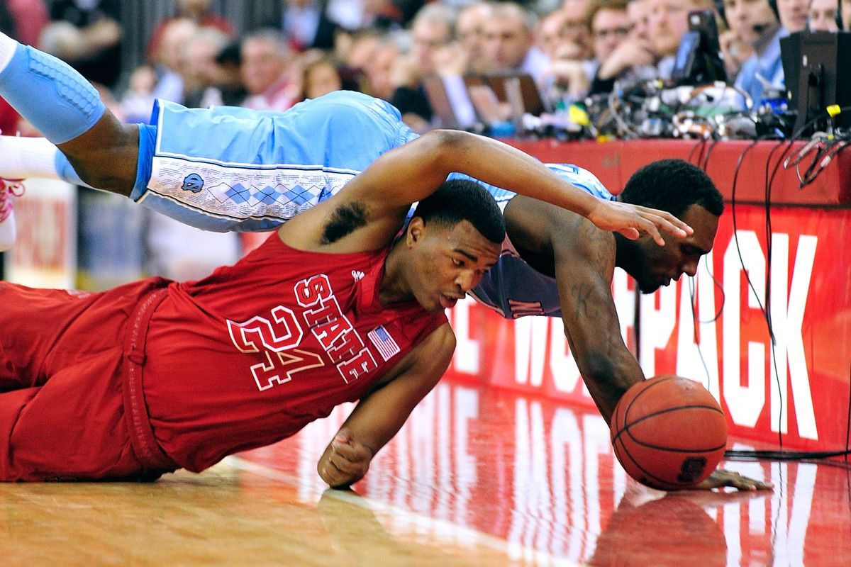 T.J. Warren and P.J. Hairston dive for a loose ball.
