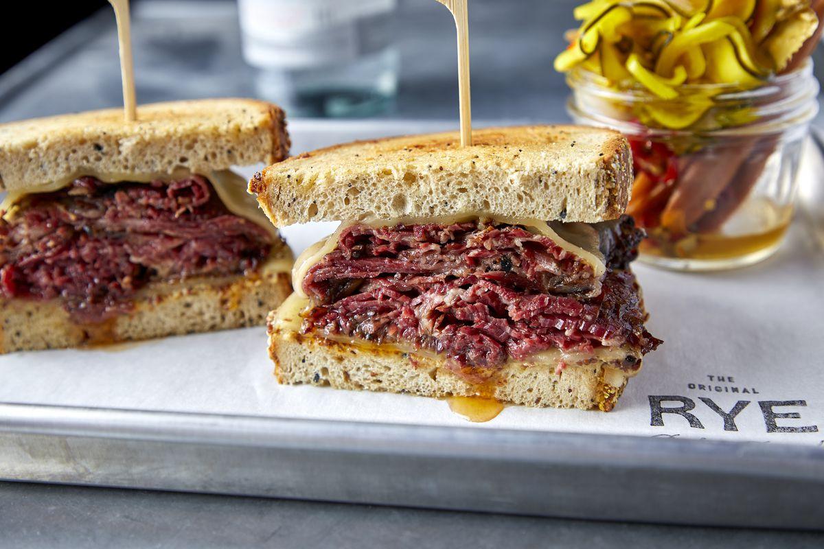 A Reuben sandwich on a metal tray