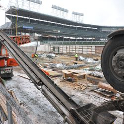 Concrete being transferred via the conveyor belt to the bleachers