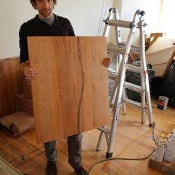 David Levi displays a finished tabletop.