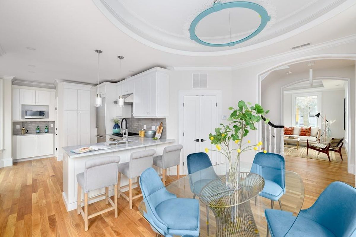 An open kitchen-dining room with a table and chairs.