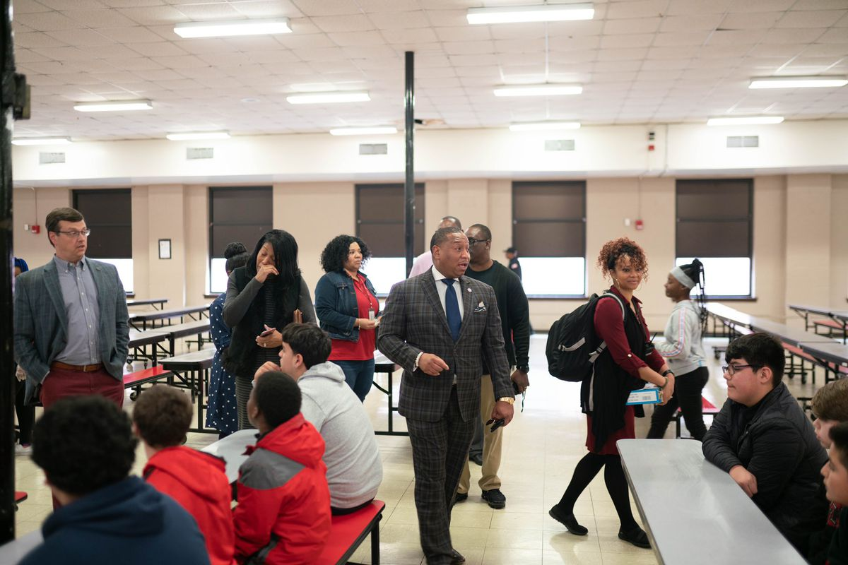 Joris Ray and other school officials walk around talking with Treadwell Middle students and staff in the cafeteria