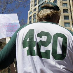Medical marijuana supporter J.W. Marshall wears a 420 shirt from Oaksterdam University during a rally outside of the Ronald V. Dellums Federal Building in Oakland, Calif., Friday, April 20, 2012.