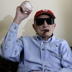 Cuban former pitcher Conrado Marrero, who once played with the Washington Senators, holds up a ball as he poses for pictures during an interview in Havana, Cuba, Wednesday, April 25, 2012. Marrero, who last year became the oldest living former big leaguer, turned 101 on Wednesday.
