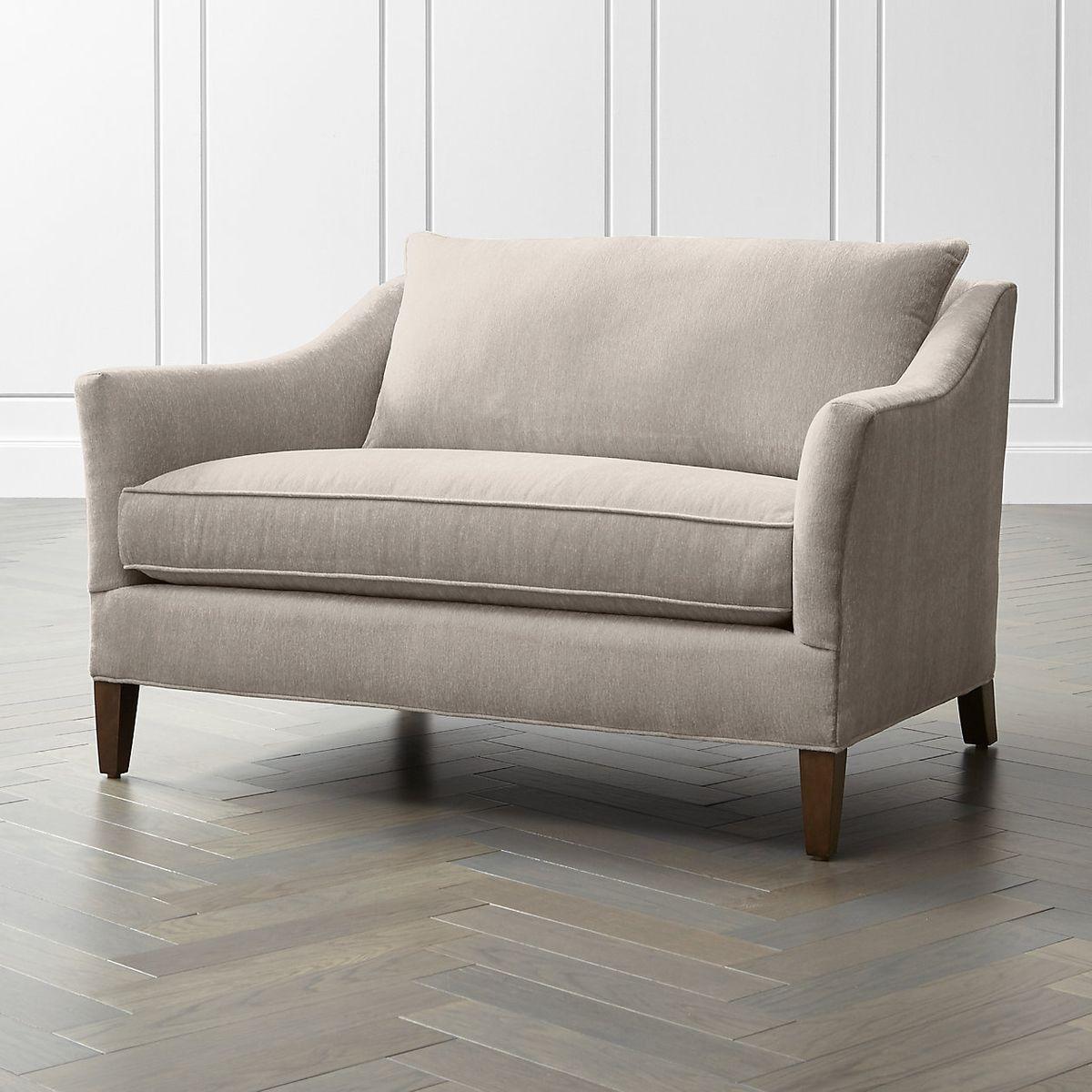 Wide beige one-seat sofa.