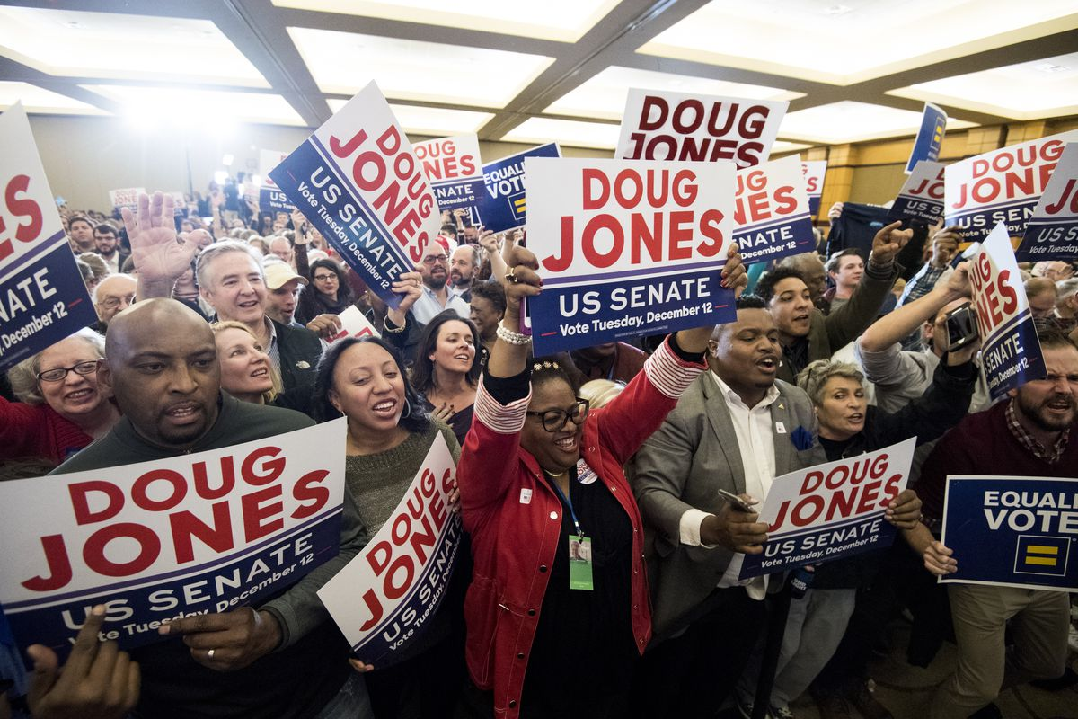 Supporters of Doug Jones celebrate his victory over Roy Moore on December 12