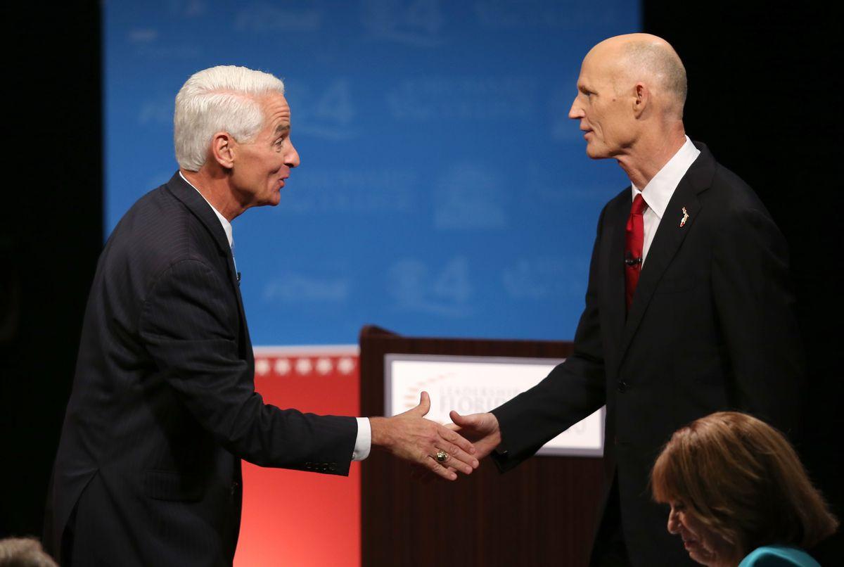 Charlie Crist and Rick Scott at a debate