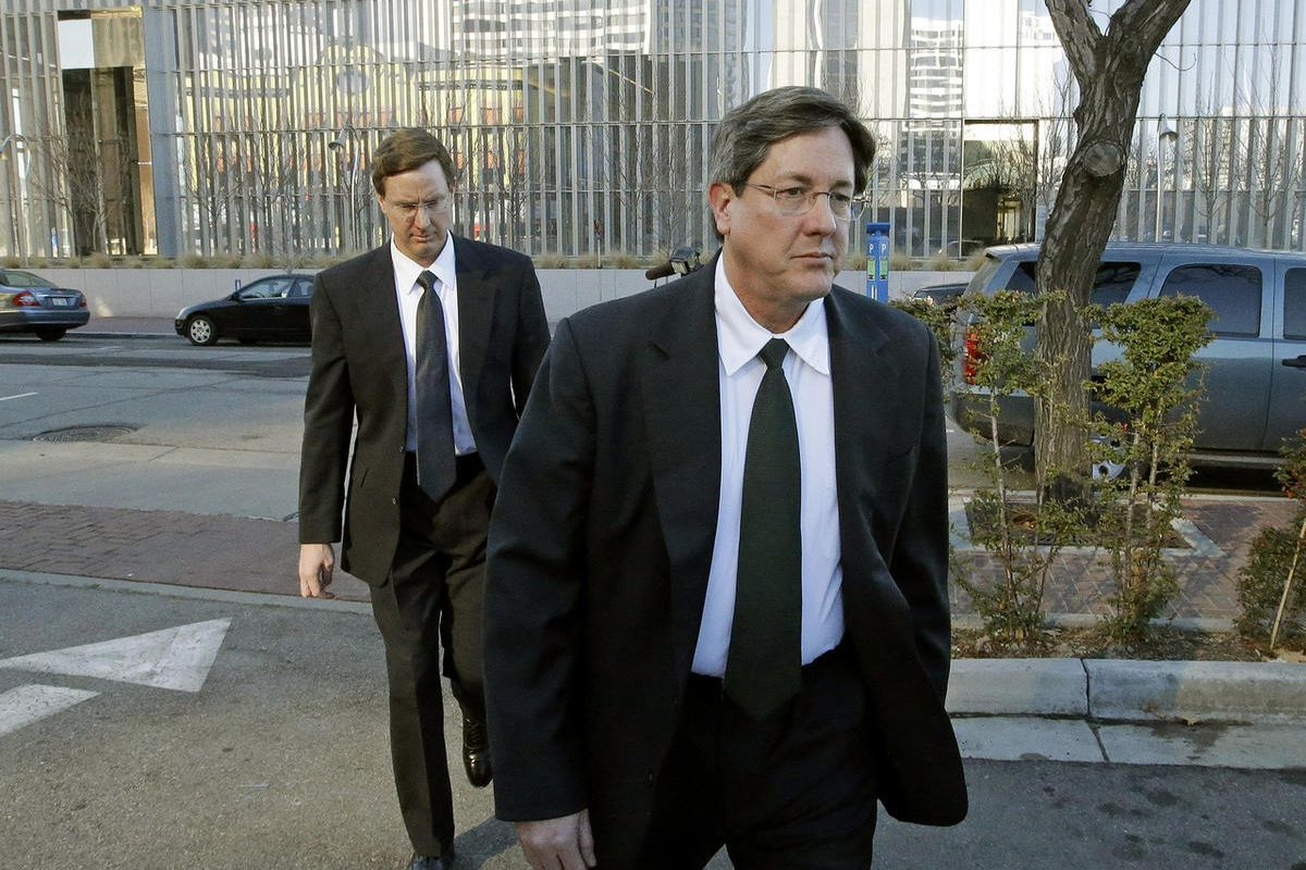 In this Jan. 21, 2015, file photo, brothers of polygamous sect leader Warren Jeffs, Lyle, foreground, and Nephi, leave the federal courthouse in Salt Lake City.