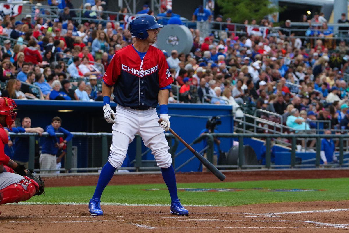 Bubba Starling batting in front of a sellout in Omaha.
