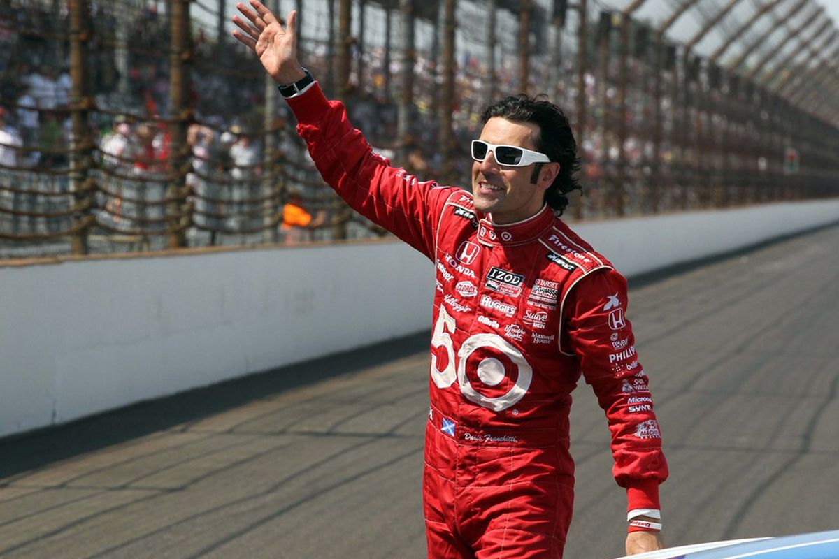 May 27, 2012; Indianapolis, IN, USA; IndyCar driver Dario Franchitti waves to the crowd after winning the 2012 Indianapolis 500 at the Indianapolis Motor Speedway. Mandatory Credit: Brian Spurlock-US PRESSWIRE