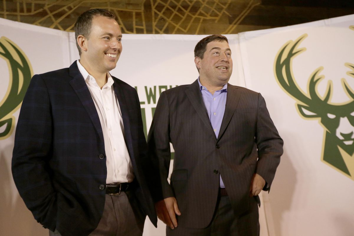 Milwaukee Bucks president Peter Feigin introduces new general manager Jon Horst during a news conference at the Milwaukee Bucks business operations office.