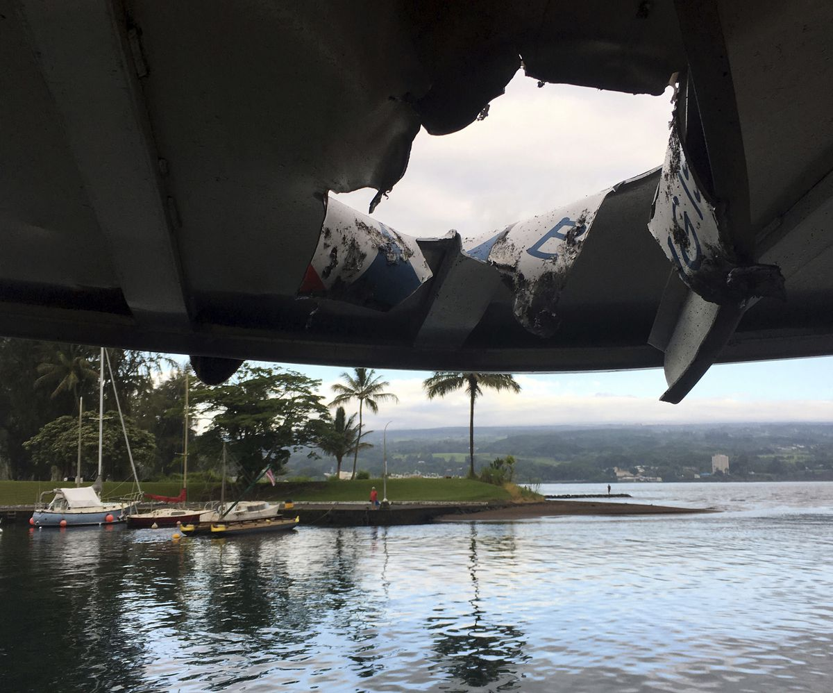 Damage to the roof of a tour boat after an explosion sent lava flying through the roof Monday, July 16, 2018. (Hawaii Department of Land and Natural Resources via AP)