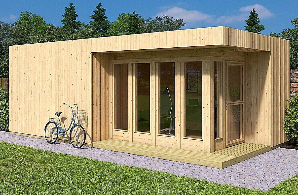 A timber tiny home has tall windows and a door on one side, with an overhanging roof that creates a small patio.